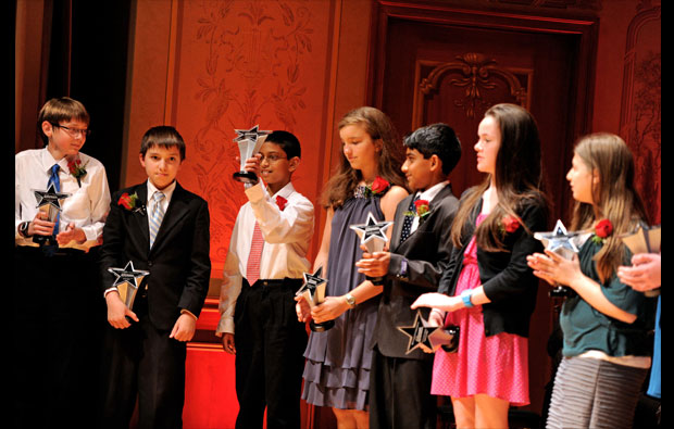 Copley-Fairlawn 6th grader Srikar Dudipal holds up his trophy as he hears he won the $300 First Prize for his grade level